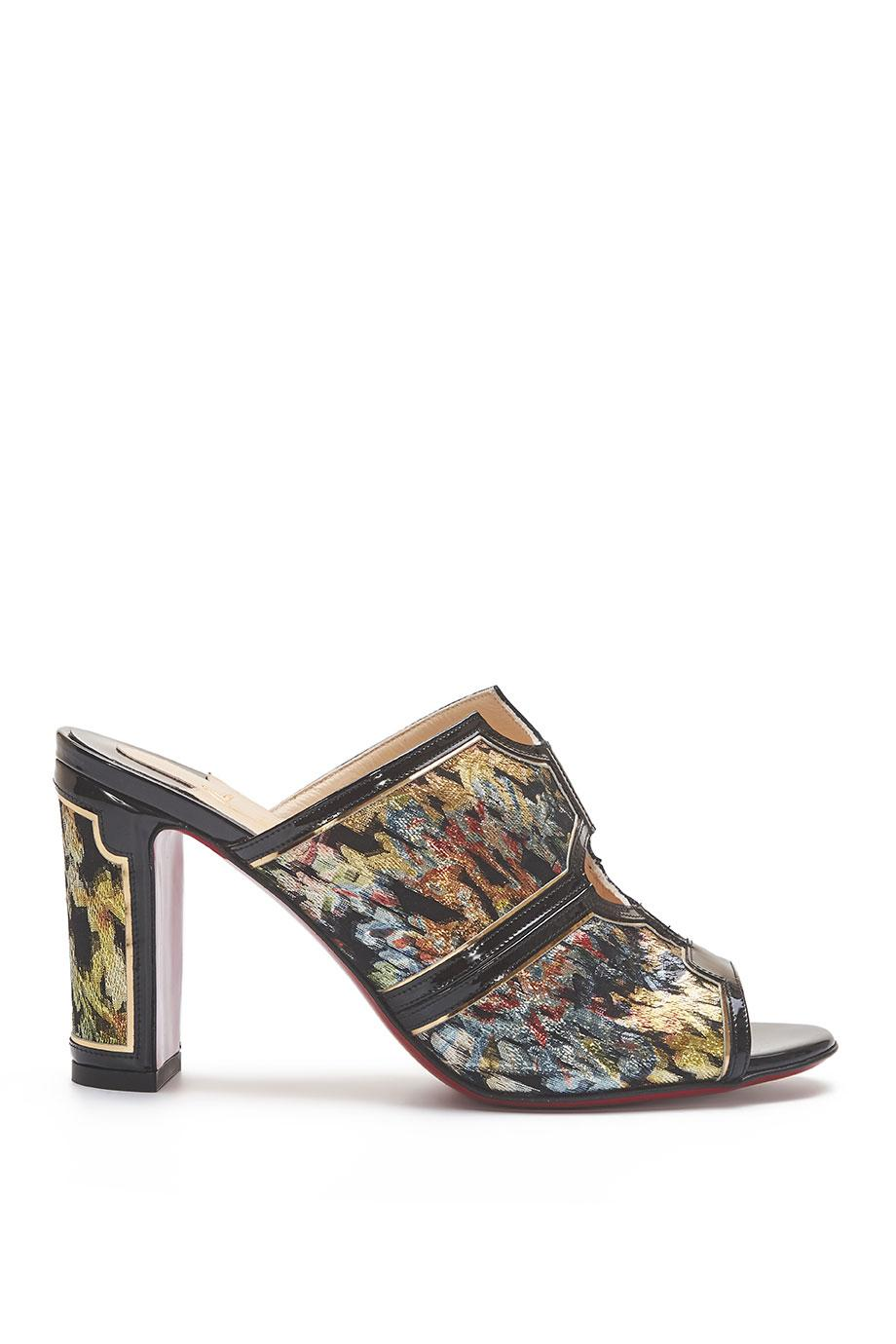 Interior brocade and glossed-leather mules